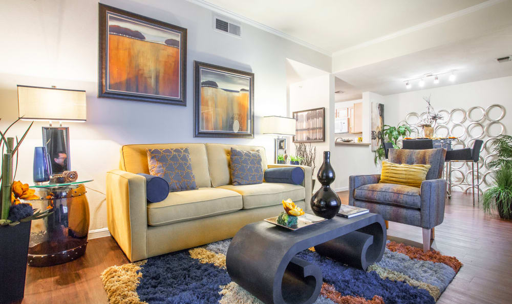 Well-decorated living area in the open-concept floor plan of a model home at Riata Austin in Austin, Texas