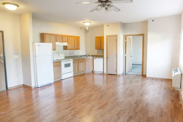Wood flooring in the kitchen and dining room at Crown Point Apartments in Ames, Iowa