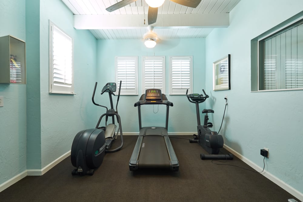 Fitness center with a ceiling fan at Breakwater Apartments in Santa Cruz, California