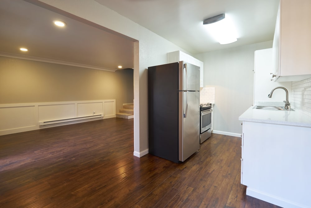 Kitchen and hall with hardwood floors at Breakwater Apartments in Santa Cruz, California