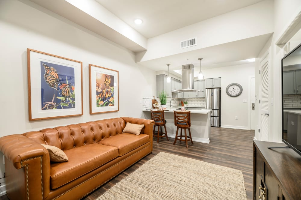 Photo of Living Room that Overlooks into Kitchen