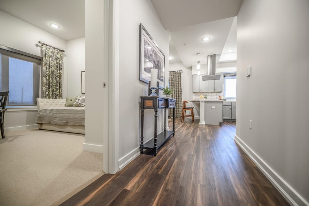 Photo of Hallway with a View of Second Bedroom and Kitchen