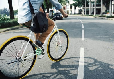 Resident biking to work near New Orleans Park Apartments in Secane, Pennsylvania