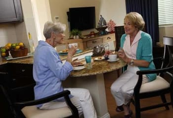 Two women enjoying breakfast at Discovery Village At Boynton Beach