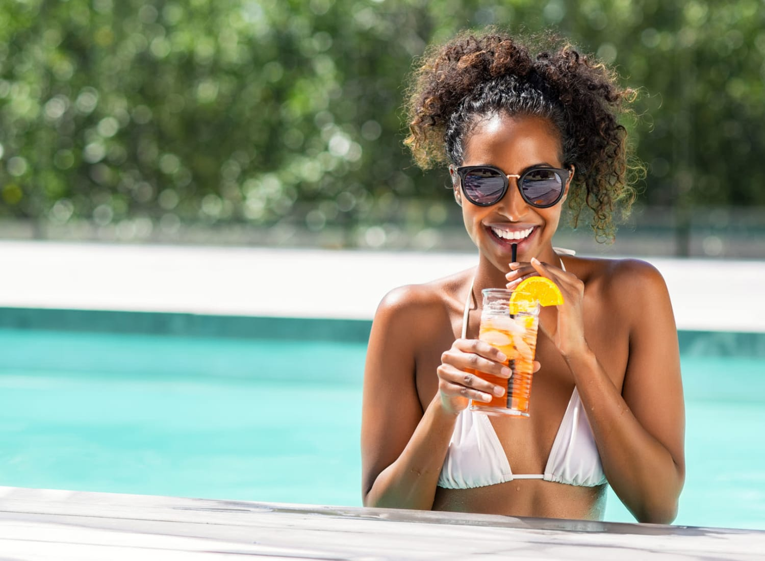 Resident at the pool enjoying a drink at The Reserve at White Oak in Garner, North Carolina