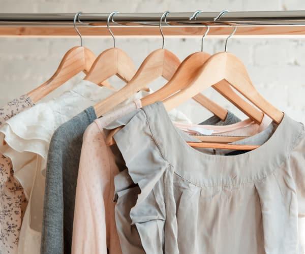 Clothes hanging in a closet at Alta Grande