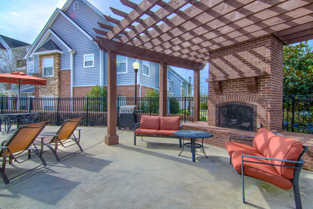 Large outdoor lounge with a fireplace and gas-fueled barbecues at Reserve at Long Point in Hattiesburg, Mississippi