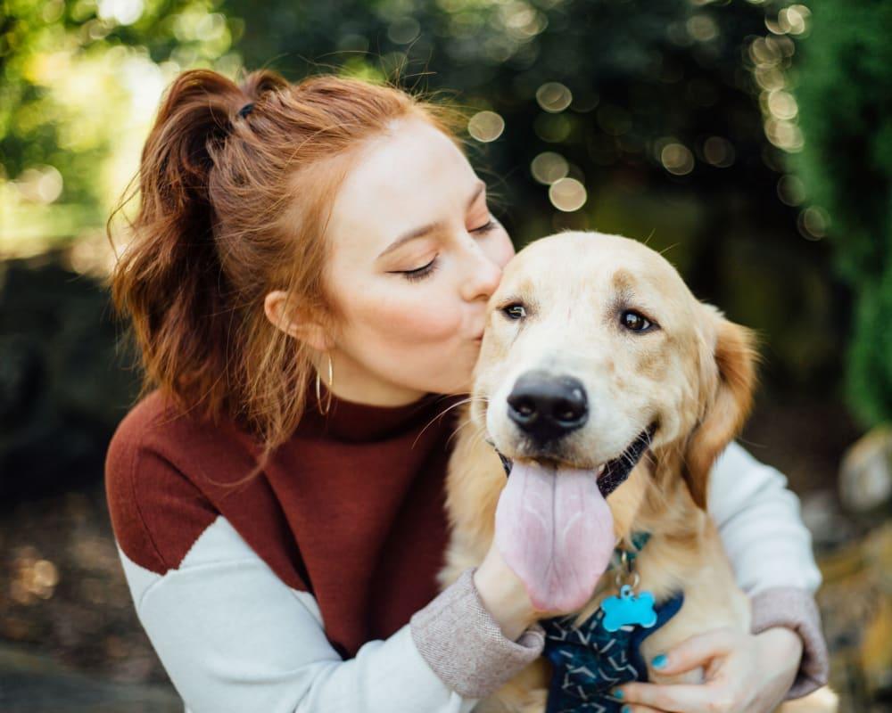 A resident loving on her dog at Encore Tessera in Phoenix, Arizona