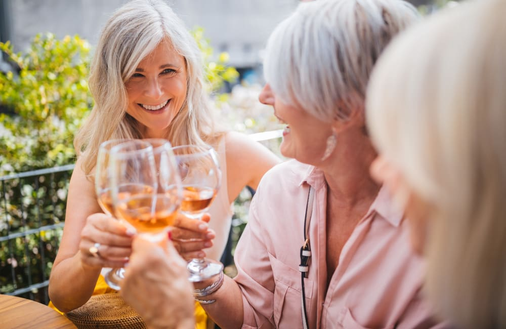 Residents drinking wine outside at Quail Park at Morrison Ranch in Gilbert, Arizona