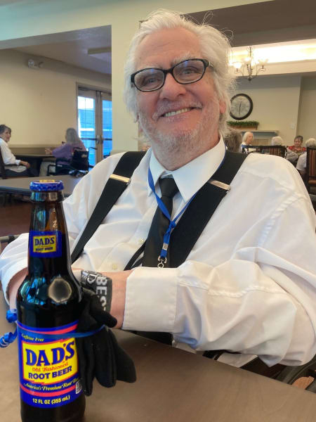 A Cottonwood Heights (UT) resident poses with his bottle of Dad's Root Beer.