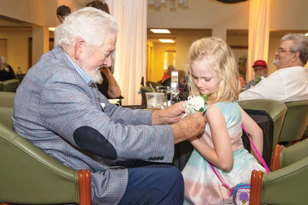 Resident and his granddaughter at Cedarview Gracious Retirement Living in Woodstock, Ontario
