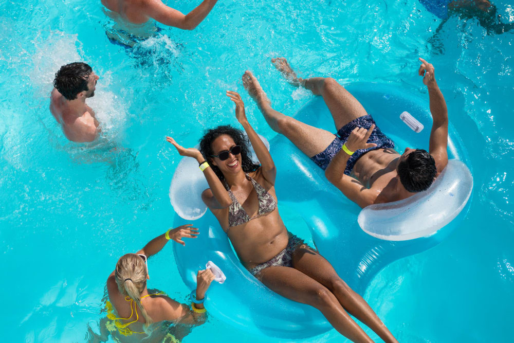 Swimming pool with a sundeck and chairs at Tavalo at Cadence in Mesa, Arizona