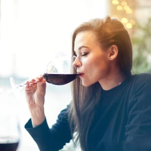 Resident enjoying a glass of wine in a local restaurant near Tower 737 Condominium Rentals in San Francisco, California