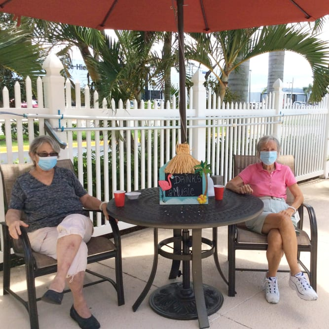 Residents sitting outside on patio