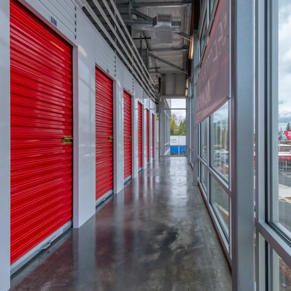Indoor storage units with red doors at StorQuest Self Storage in Portland, Oregon