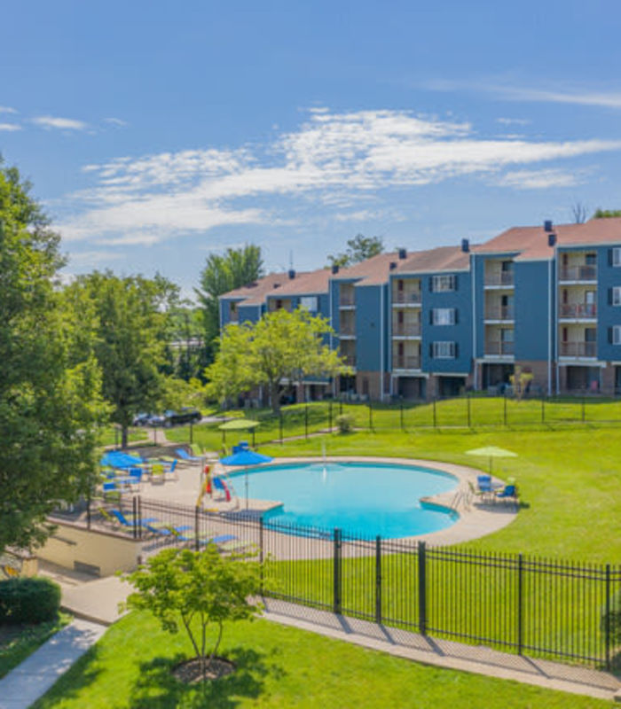 Swimming pool area on a sunny day at Eagle Rock Apartments at Towson in Towson, Maryland