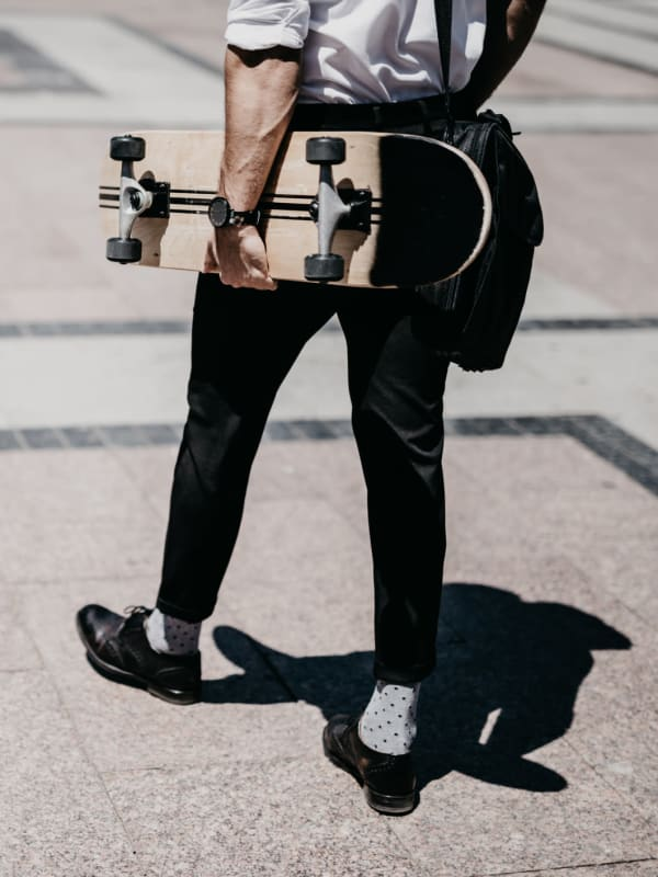 Resident carrying a skateboard in Houston, Texas near Bellrock Summer Street