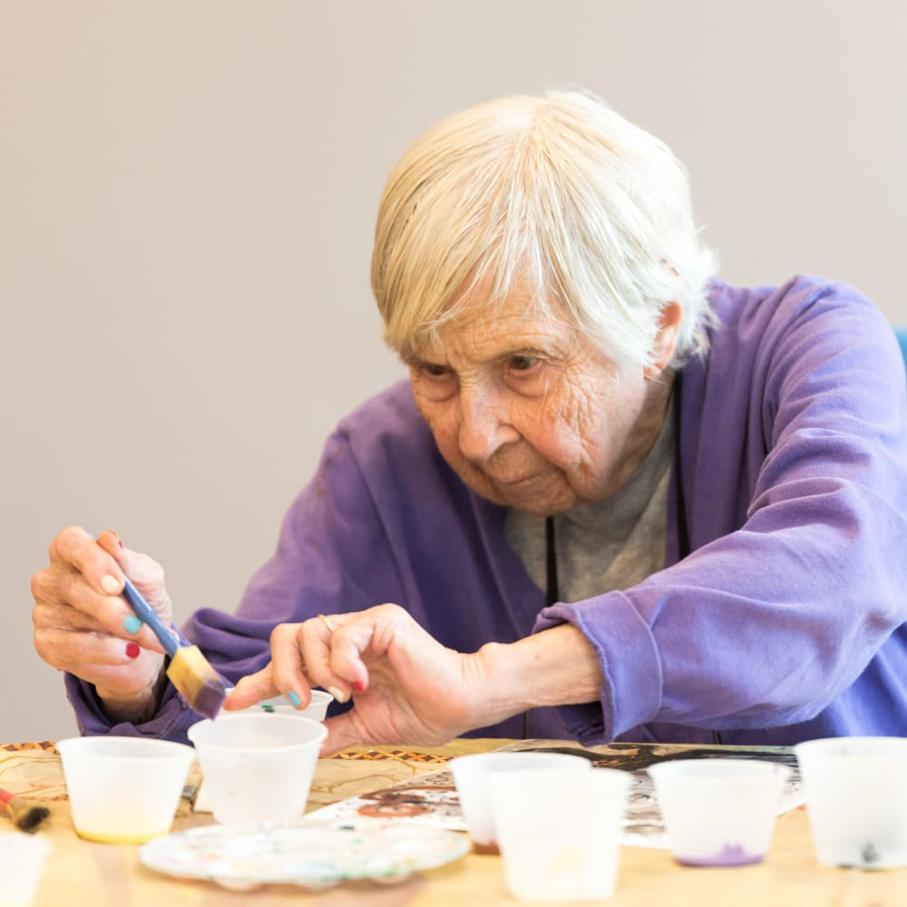 Woman making an art project at Inspired Living in Sarasota, Florida.