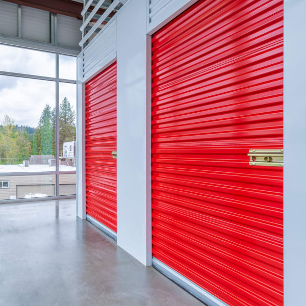 Indoor storage units with red doors at StorQuest Self Storage in Seattle, Washington