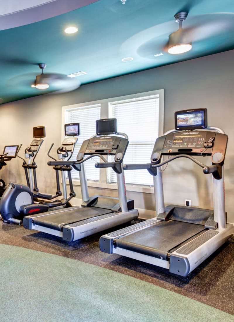 Fitness center featuring treadmills at Marquis at Morrison Plantation in Mooresville, North Carolina