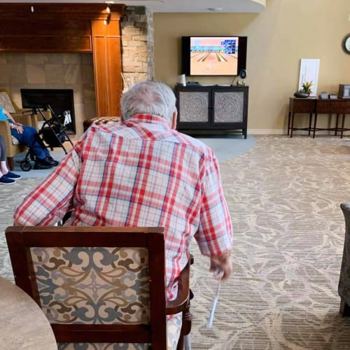 Resident playing wii at The Oxford Grand Assisted Living & Memory Care in Kansas City, Missouri