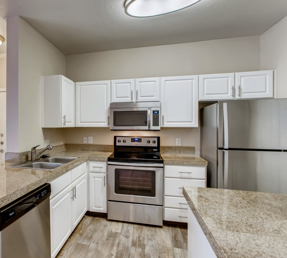 Kitchen with white cabinets and stainless-steel appliances at Cortland Village Apartment Homes in Hillsboro, Oregon