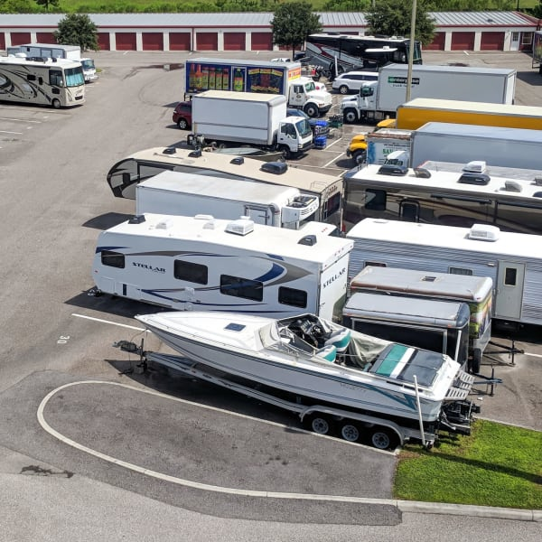RVs, boats, trucks, and trailers parked at StorQuest Self Storage in Tucson, Arizona
