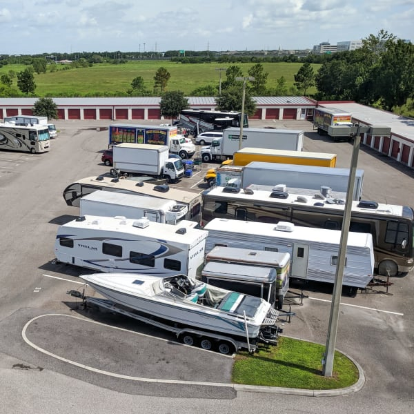 RVs, boats, trucks, and trailers parked at StorQuest Self Storage in Sanford, Florida