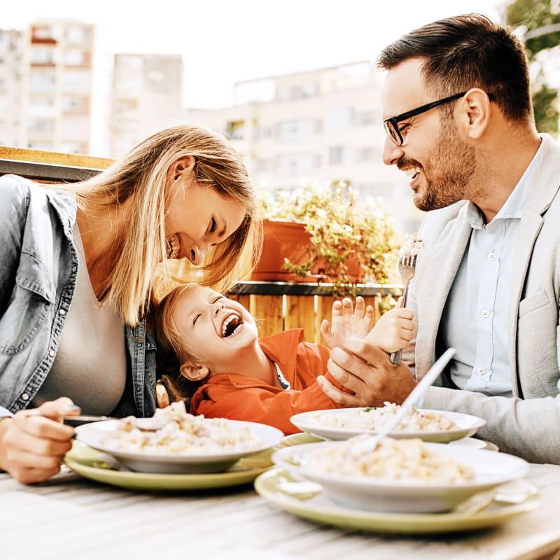 Family enjoying dinner near 6 West Apartments in Edwards, Colorado