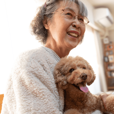 A resident with her dog at Milestone Retirement Communities