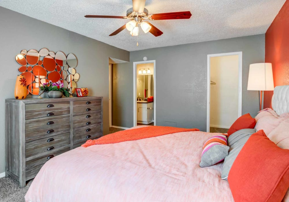 Bedroom with red accents at Sausalito Apartments in College Station, Texas