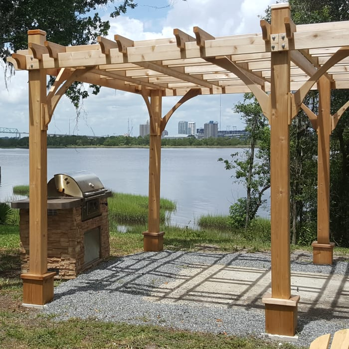 Grilling area alongside the sparkling St Johns River at Pier 5350 in Jacksonville, Florida