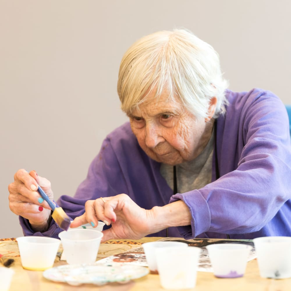 Resident making an art project at Inspired Living Hidden Lakes in Bradenton, Florida.