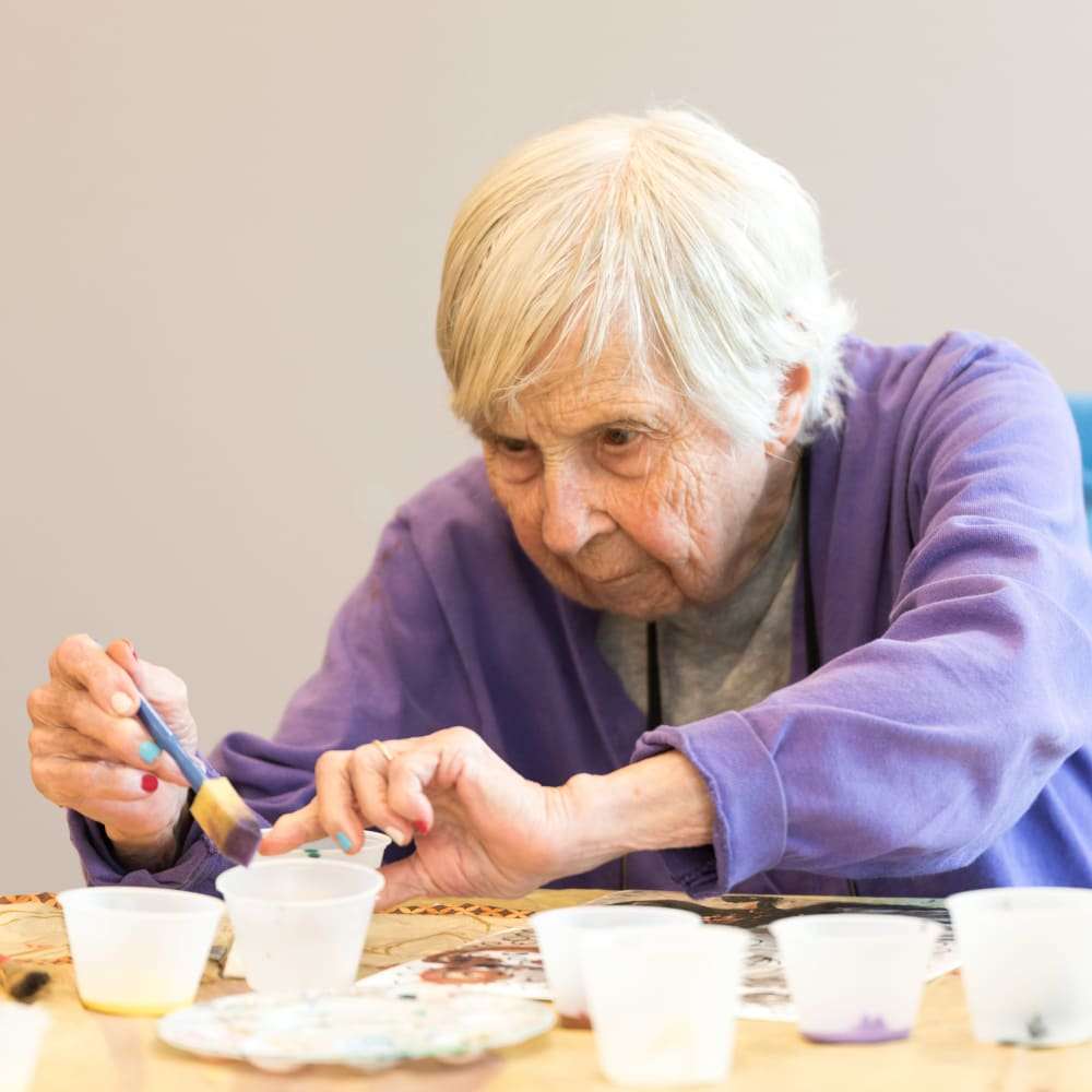 Resident making an art project at Inspired Living Ivy Ridge in St Petersburg, Florida.