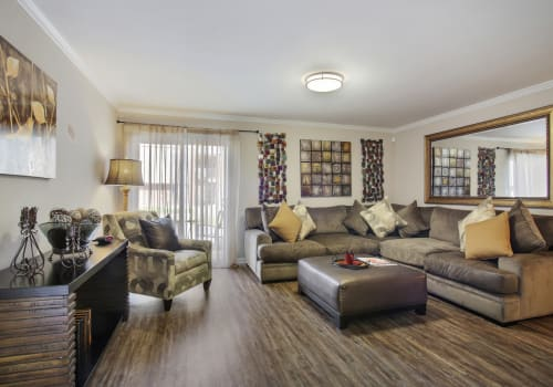 Corporate unit living room at Emerald Pointe Apartment Homes in Harvey, Louisiana