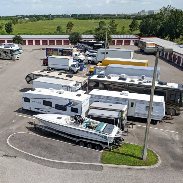 RVs, boats, and trucks parked at StorQuest Self Storage in Odessa, Florida