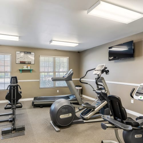 Well-equipped fitness center at Indian Footprints Apartments in Harrison, Ohio
