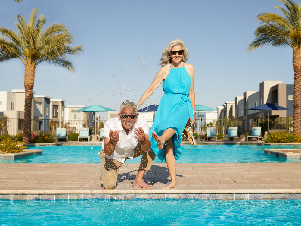 Two residents by the pool at Las Casas at Windrose in Litchfield Park, Arizona