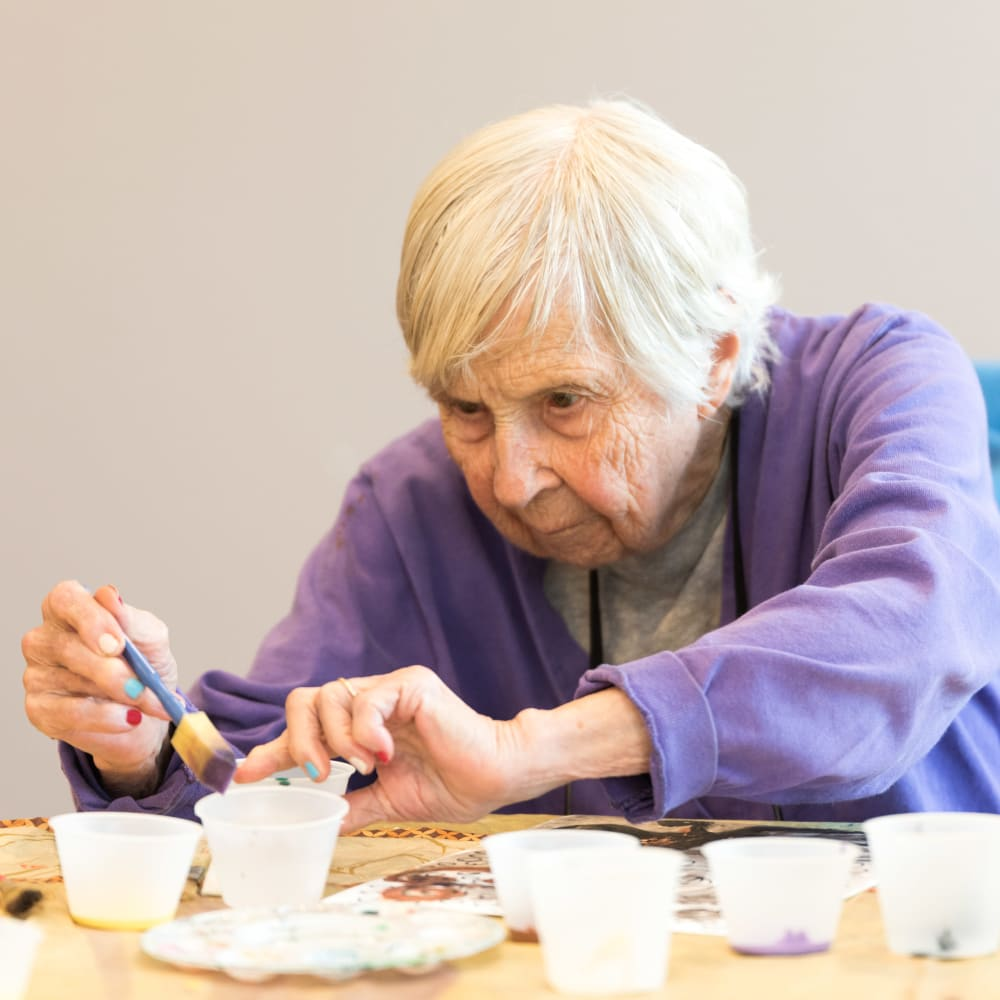 Resident making an art project at Inspired Living Tampa in Tampa, Florida.