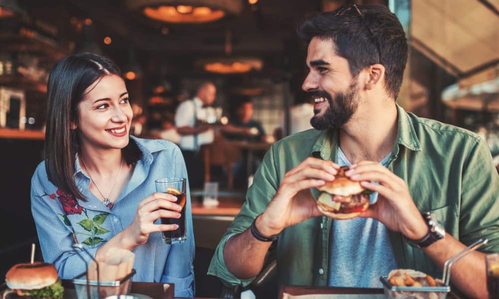 Friends enjoying some big burgers at their favorite spot in town near Verandas at Alamo Ranch in San Antonio, Texas