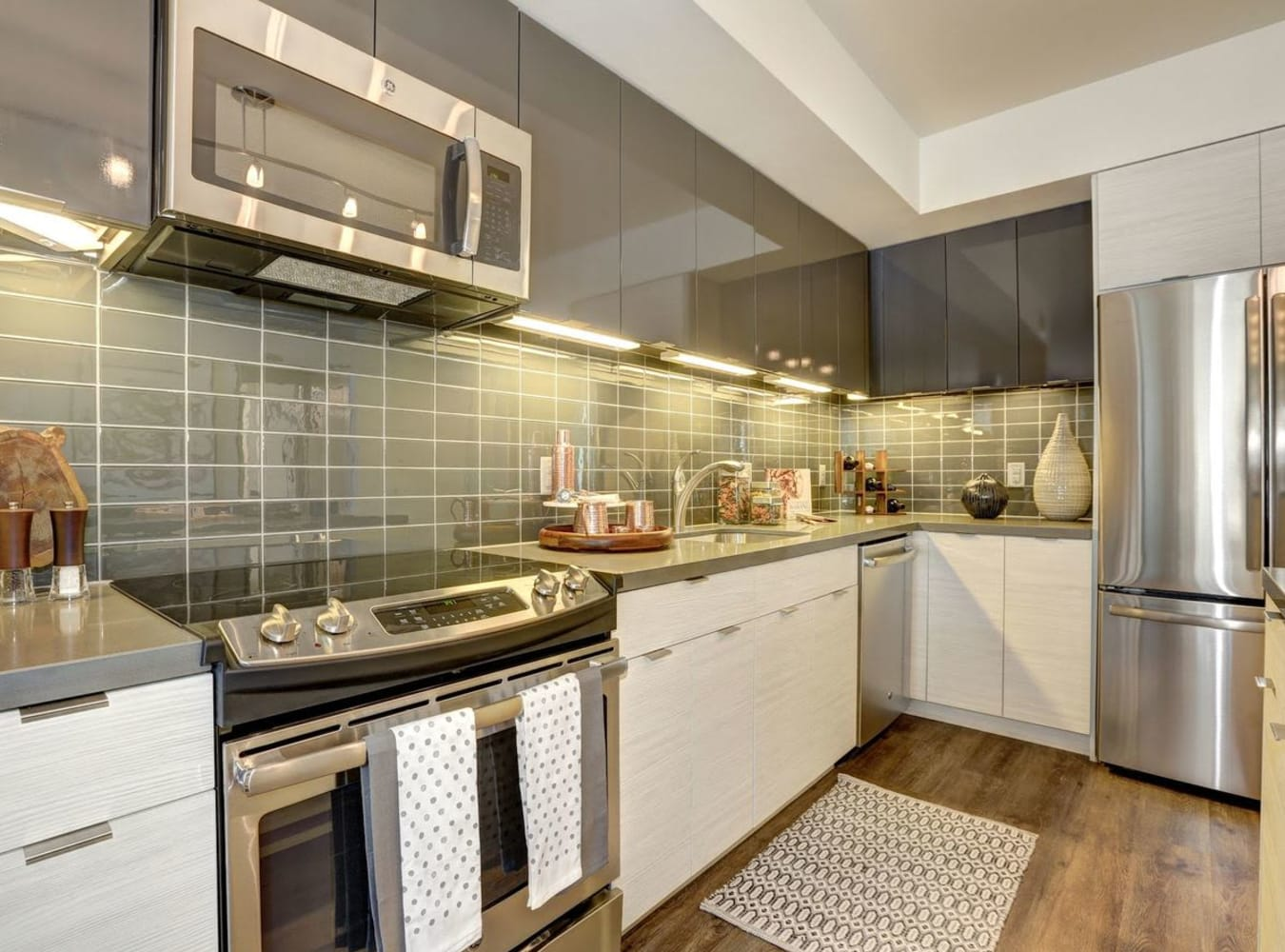 A kitchen with stainless-steel appliances at Solaire 7077 Woodmont in Bethesda, Maryland
