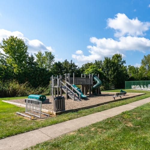 Playground with a bike rack at Indian Footprints Apartments in Harrison, Ohio