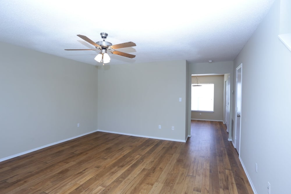 Spacious room with hard wood style flooring at Madison Pines in Madison, Alabama