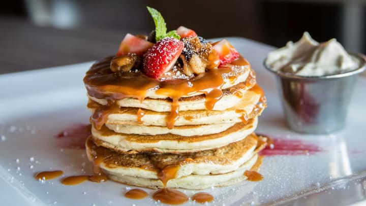 Stack of pancakes at a restaurant near Olympus Midtown in Nashville, Tennessee