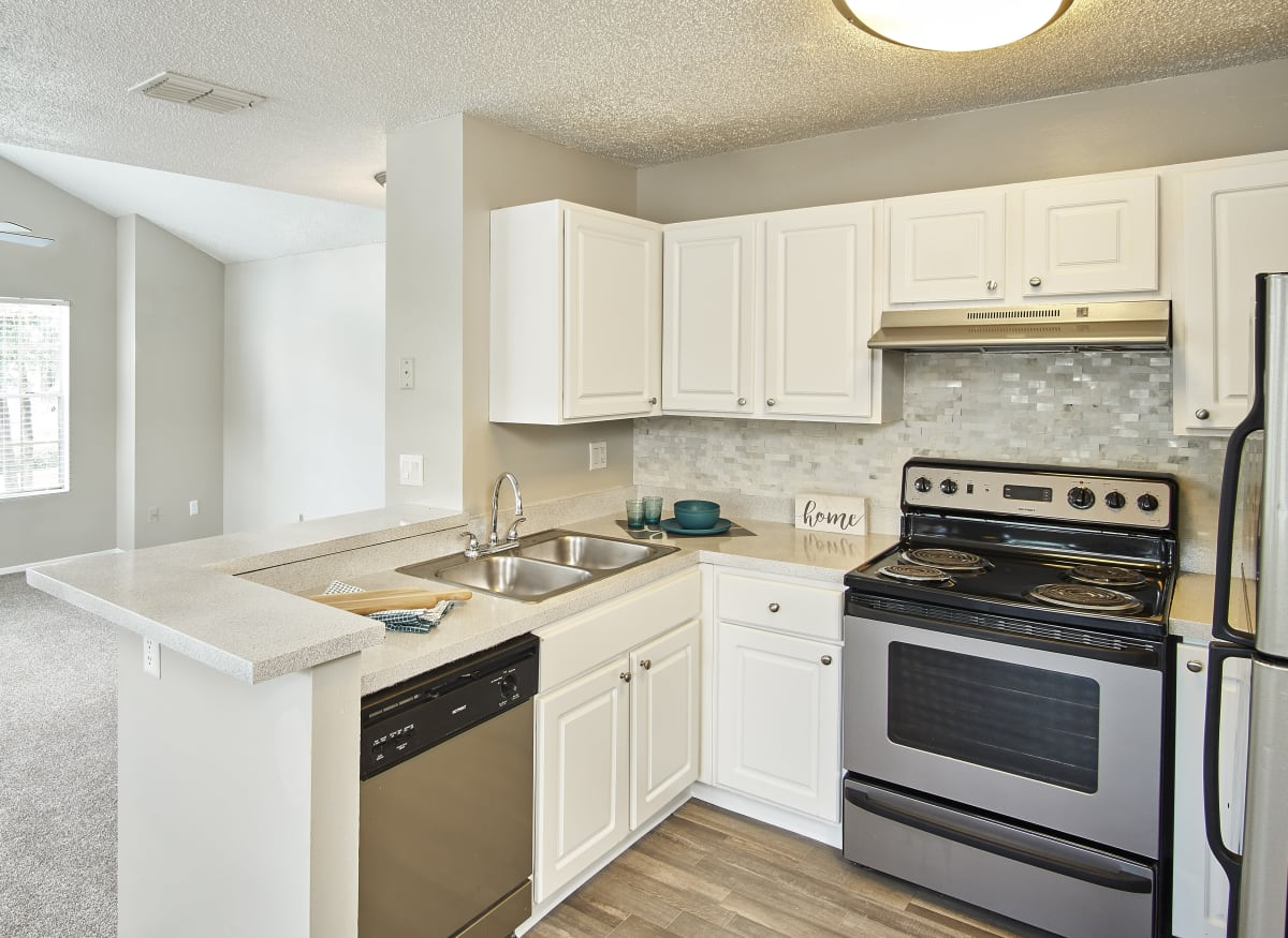 A kitchen with stainless-steel appliances at Avenue @Creekbridge in Brandon, Florida