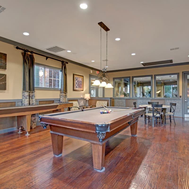 Billiards table in Vista 121 Apartment Homes's clubhouse in Lewisville, Texas