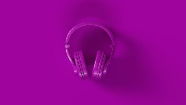 Purple headphones on purple background