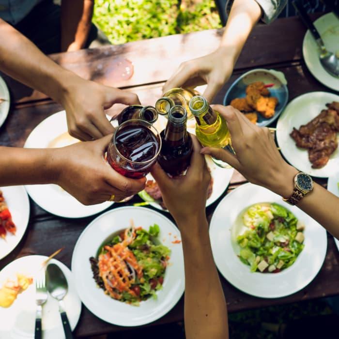 Friends enjoying dinner and drinks in Tulsa, Oklahoma near Windsail Apartments