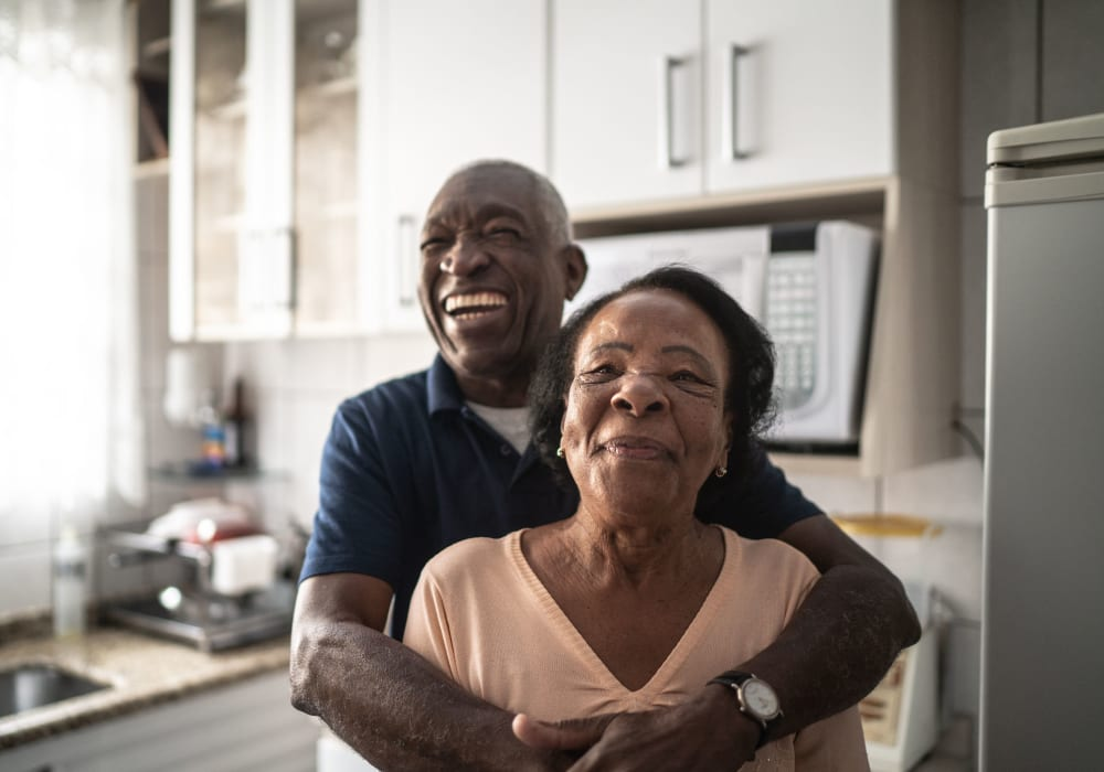 Resident couple hugging at Kingston Bay Senior Living in Fresno, California.