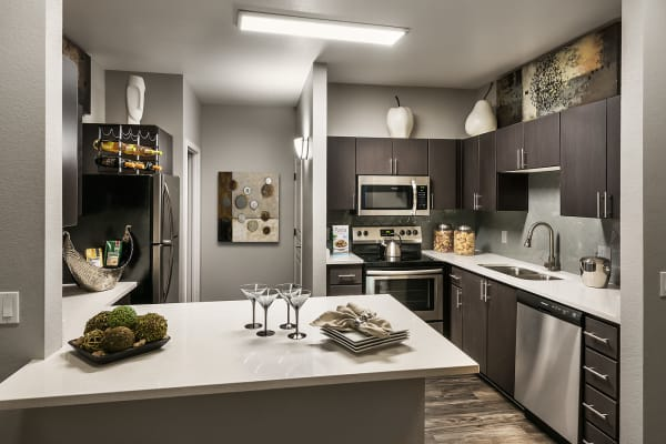Modern kitchen with plenty of counter space at Avenue 25 Apartments in Phoenix, Arizona